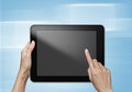 Hand touch screen on tablet pc with icons Stock Image