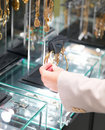 Hand touching bracelets in jewellery shop Stock Images