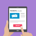 Hand touching screen of tablet computer with buy button and tickets icon on screen. Concept of online tickets mobile Royalty Free Stock Photo