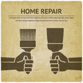 Hand with trowel and brush. home repair paint concept