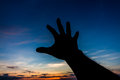 Hand try to reach something silhouette in sky Royalty Free Stock Image