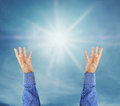 Hand trying to reach on the sky with sunshine rays Royalty Free Stock Photo