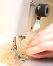 Hand is trying to thread the needle of a sewing machine woman s Royalty Free Stock Photography