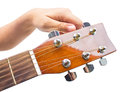 Hand tuning a guitar from headstock isolated on white background Royalty Free Stock Photography