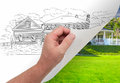 Hand Turning Page of Custom Home Drawing To Photograph Royalty Free Stock Photo