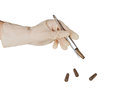 Hand, tweezers, gun shells isolated Stock Image