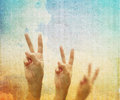 Hand with two fingers up in the peace or victory symbol. Royalty Free Stock Photo