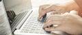 Hand typing keyboard on laptop Royalty Free Stock Photo