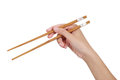 Hand Using Chopsticks. Royalty Free Stock Photo
