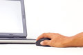 Hand using wireless laptop mouse. Stock Images