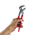 Hand using a wrench Royalty Free Stock Photo