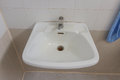 Hand wash basin, white sink and faucet Royalty Free Stock Photo