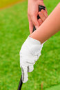 Hand with white gloves holding a putter golf Royalty Free Stock Photography