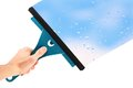 Hand with window cleaning tool Royalty Free Stock Photo