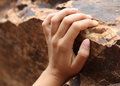 Hand of a woman climbing on the rock womans in beautiful brown colors Royalty Free Stock Photography