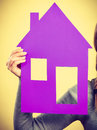 Hand of woman holding house model. Royalty Free Stock Photo