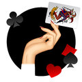 Hand of woman holding Joker playing card on the round black back Royalty Free Stock Photo