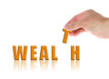 Hand and word Wealth Royalty Free Stock Photo