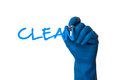 Hand writing clean in cleaning glove isolated on white background Stock Photo