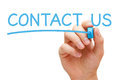 Hand writing contact us blue marker transparent wipe board Stock Photo