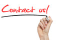 Hand writing contact us with red marker on transparent wipe board Stock Photos