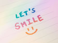 Hand writing on paper let's smile and draw smiley message colored filter effect Stock Images