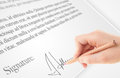 Hand writing personal signature on a paper form legal Stock Photo