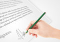 Hand writing personal signature on a paper form legal Stock Image