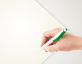Hand writing on plain empty white paper copy space with pen Royalty Free Stock Photo