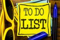 Hand writing text caption inspiration showing To Do List. Business concept for Plan Lists Remider Written on sticky note paper, wo Royalty Free Stock Photo