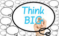 Hand writing think big clear glass whiteboard female with light blue felt tip or marker inside bubble competing with smaller ones Royalty Free Stock Photos