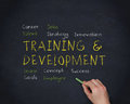 Hand writing training and development with a chalk on black background Stock Images