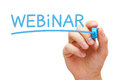 Hand writing webinar with blue marker on transparent wipe board Stock Photo