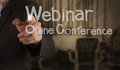 Hand writing webinar with crumpled paper background as concept Stock Images