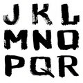 Hand written black ink alphabet Stock Photography