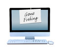 Hand written gone fishing sign taped to computer a is a monitor showing that the business man or business woman worker is out on Stock Photo
