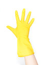 Hand with yellow glove Royalty Free Stock Images