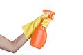 Hand in yellow protective glove spraying cleaning liquid