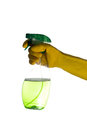 Hand with yellow rubber gloves holding a spray bottle with liquid Royalty Free Stock Photo