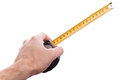 Hand with yellow tape measure Stock Photos