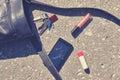 Handbag, broken phone, keys and lipstick on asphalt street. Royalty Free Stock Photo