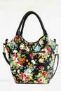 Handbag isolated over white with floral print Royalty Free Stock Photo