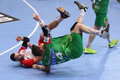 Handball foul players jakov vrankovic from dinamo bucharest and jacob bagersted from sc magdeburg fighting for the ball during the Royalty Free Stock Image