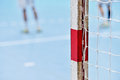 Handball goalpost with players in background detail shot and the Royalty Free Stock Image