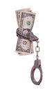 Handcuff with dollar notes Stock Photo