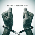 Handcuffed man and text press freedom day Royalty Free Stock Photo