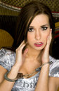 Handcuffed young woman looks distressed Royalty Free Stock Photo