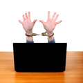 Handcuffs on hands behind laptop in isolated the white background Stock Image