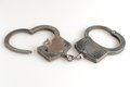 Handcuffs in heart shape and key within isolated with Royalty Free Stock Photography