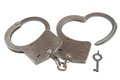 Handcuffs in heart shape and key on white background isolated Royalty Free Stock Photos
